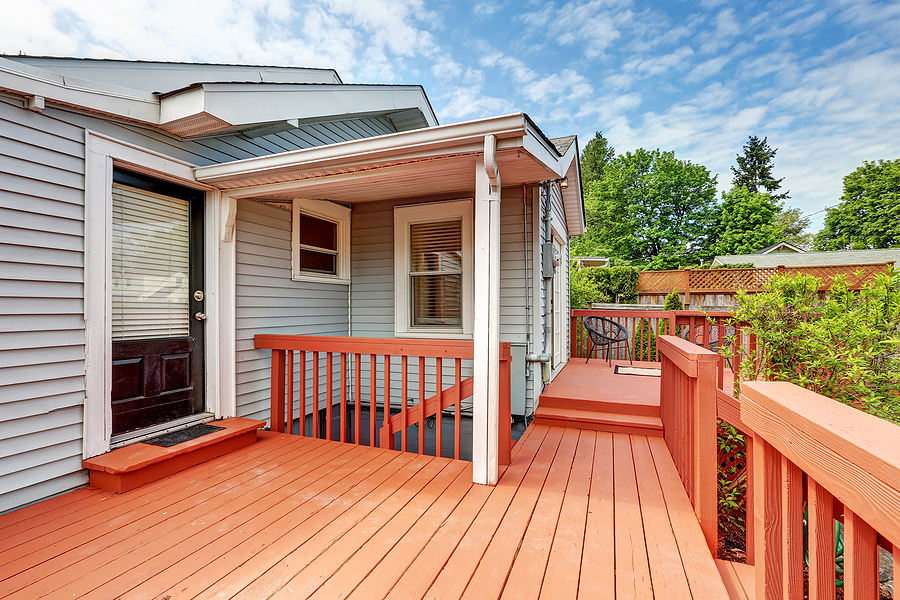 Backyard of craftsman home with red deck. Northwest USA
